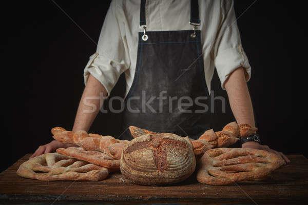 Fresh bread on the table Stock photo © artjazz