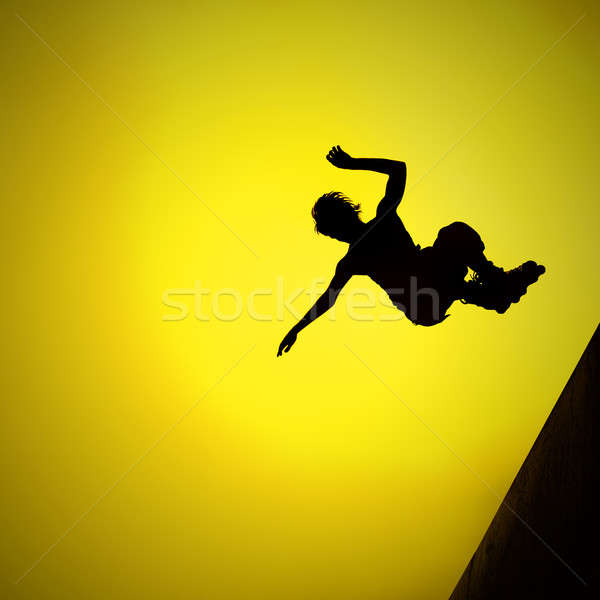 silhouette of roller boy jumping in air Stock photo © artjazz