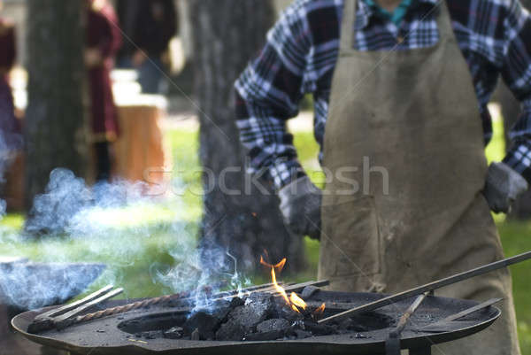 Smith against fireplace with instruments Stock photo © artjazz