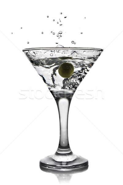 Stock photo: martini with olive and splash isolated on white