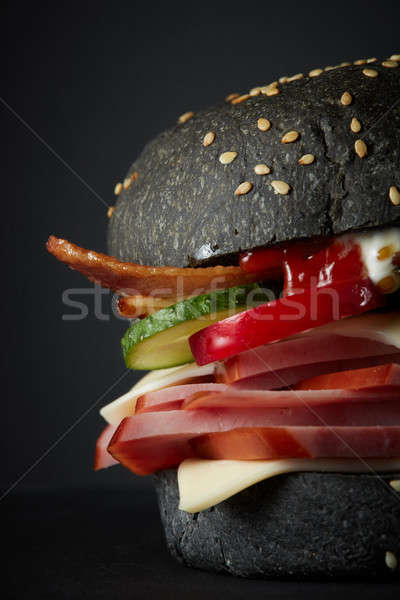 Gourmet black burger with Spicy sauce Stock photo © artjazz