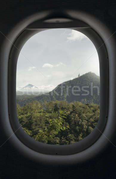 View from airplane window on tropical and mountains Stock photo © artjazz