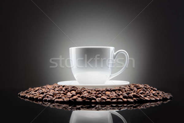 white cup with coffee beans on black Stock photo © artjazz