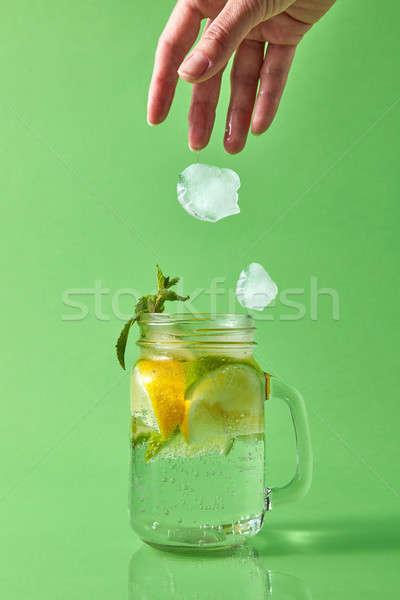 Kéz darabok jég üveg bögre természetes Stock fotó © artjazz