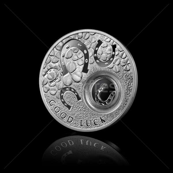 silver coin with horseshoes isolated on black Stock photo © artjazz