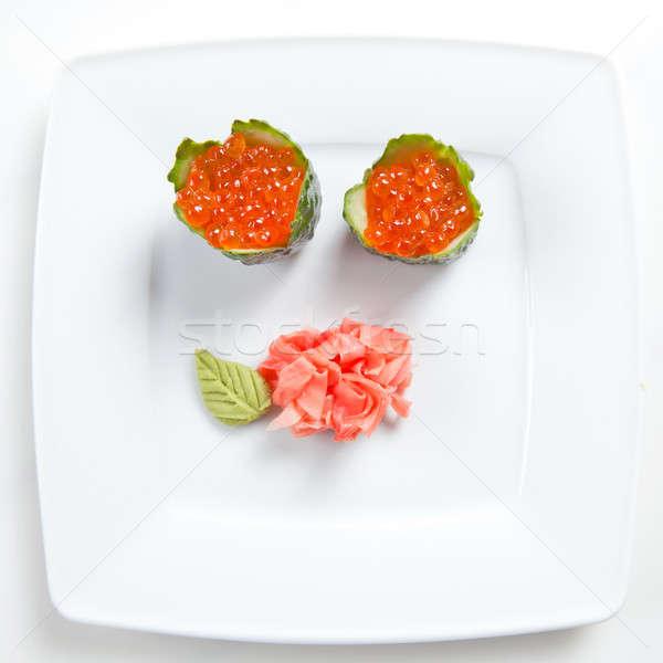Sushi caviar pepino prato isolado branco Foto stock © artjazz
