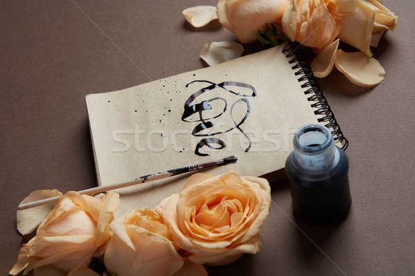Dziennik notebooka słowo miłości napisany pomoc Zdjęcia stock © artjazz