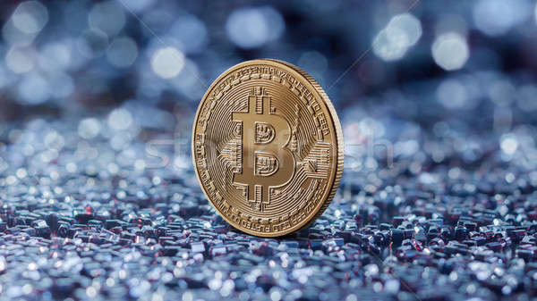 Gold coin bitcoin on a blue blurred background Stock photo © artjazz