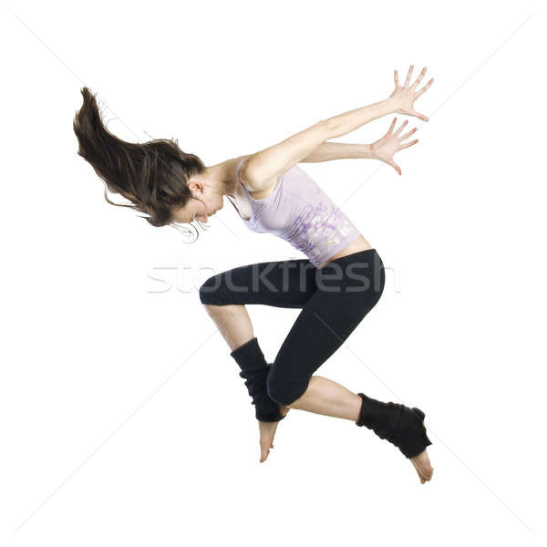 Stock photo: jumping young dancer isolated on white background