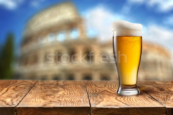Glass of beer against Colosseum Stock photo © artjazz