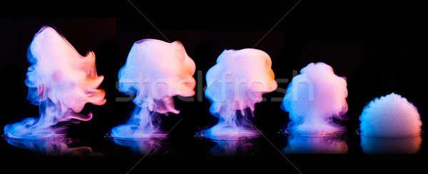 Color smoke explosion isolated on black Stock photo © artjazz