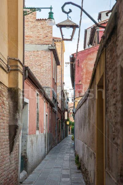 Narrow street in the old town in Venice Stock photo © artjazz