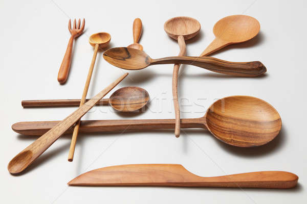 Assorted different kitchen wooden utensils cutlery Stock photo © artjazz