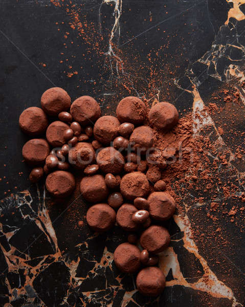Assorted dark chocolate truffles Stock photo © artjazz