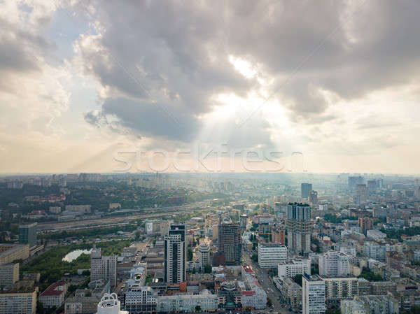 Panoramic view to a central part of Kiev, Ukraine with modern buildings on a cloudy sunset backgroun Stock photo © artjazz