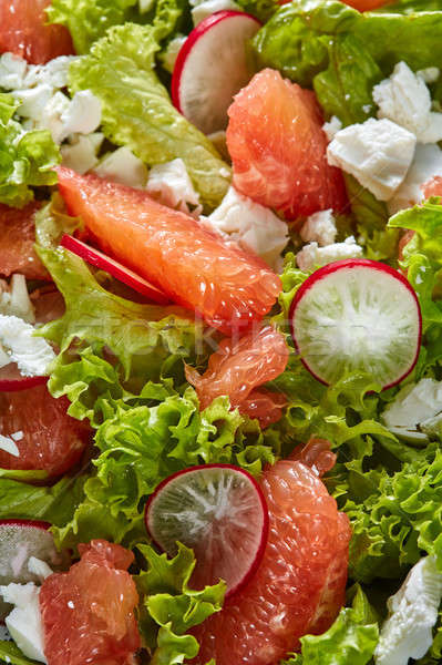 Homemade freshly salad from natural organic vegetables, fruits, cheese. Concept of healthy diet food Stock photo © artjazz