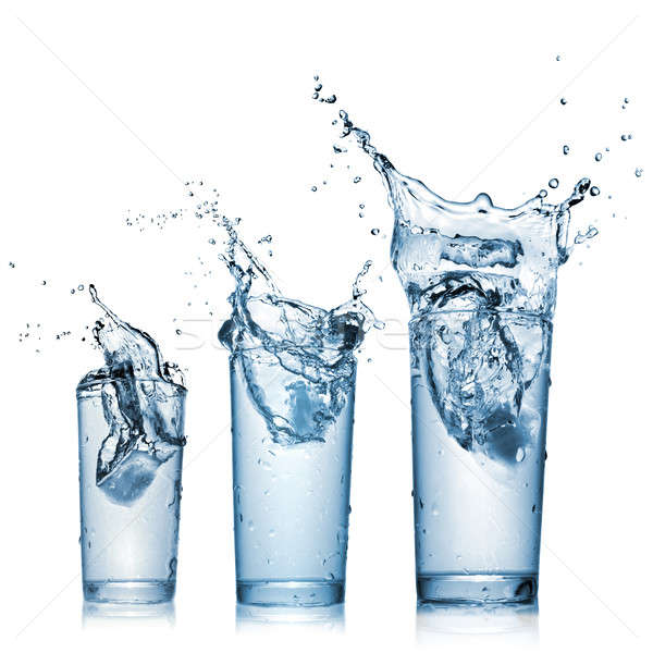 water splash in glasses isolated on white Stock photo © artjazz