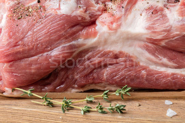 Close up photo of raw meat. Pork neck with herbs Stock photo © artjazz