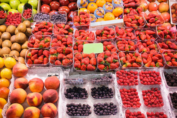 Strawberries bulk sale at outdoor market, Stock photo © artjazz