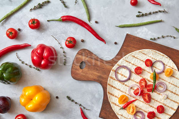 Fresh vegetables and tortilla on a wooden board Stock photo © artjazz