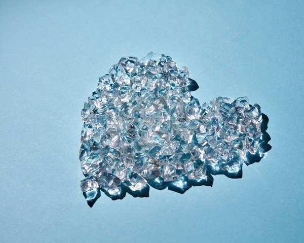 Heart of ice cubes on a blue background Stock photo © artjazz