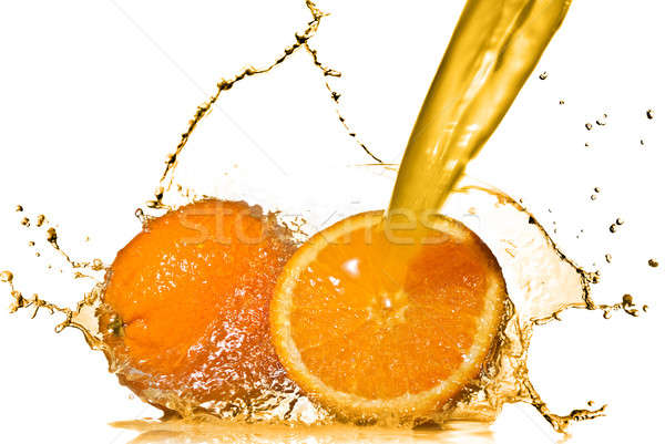 Water splash on orange isolated on white Stock photo © artjazz