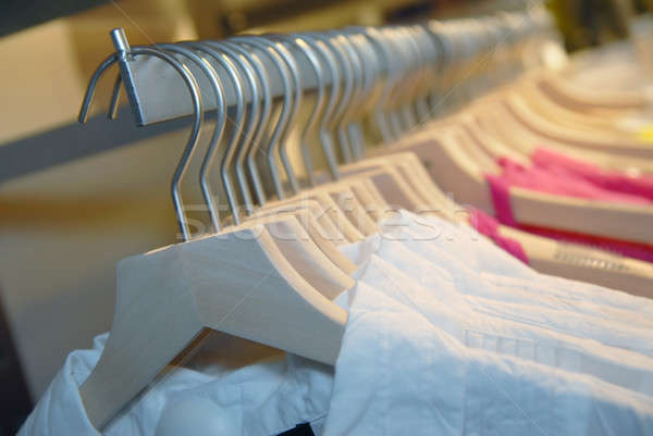 clothes on racks in store Stock photo © artjazz