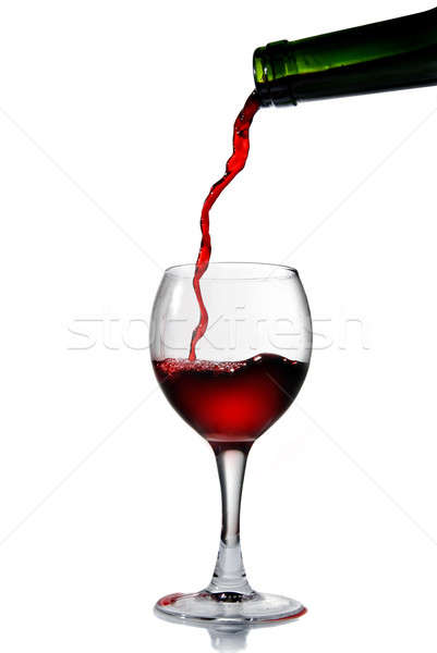 Stock photo: Pouring red wine into the goblet
