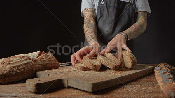 Baker Holds Bran Bread Stock photo © artjazz