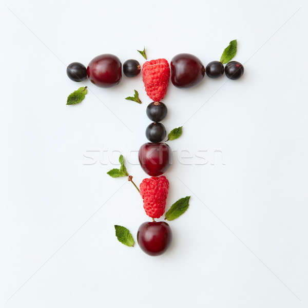 Freshly fruits pattern of letter T english alphabet from natural ripe berries - black currant, cherr Stock photo © artjazz