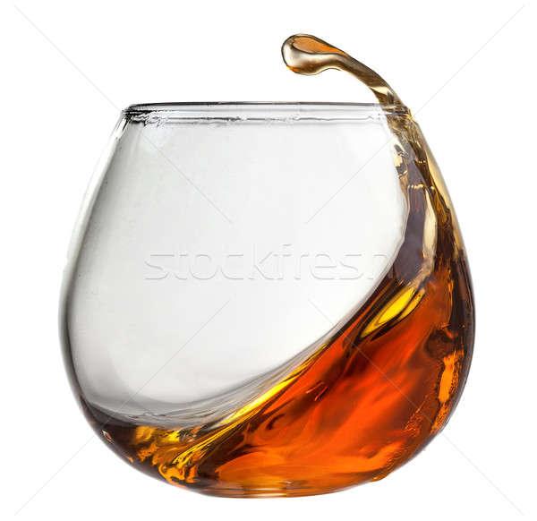 Splash cognac verre isolé blanche fête Photo stock © artjazz
