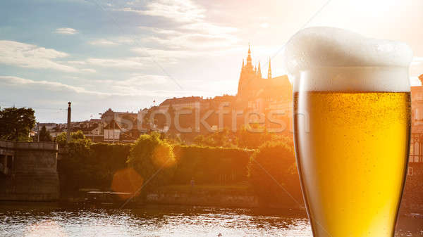 Glass of beer against view of Prague Stock photo © artjazz