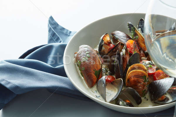 Stock photo: Mussel with white wine sauce and french frie