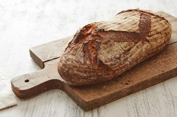 Fresh bread on wooden board Stock photo © artjazz