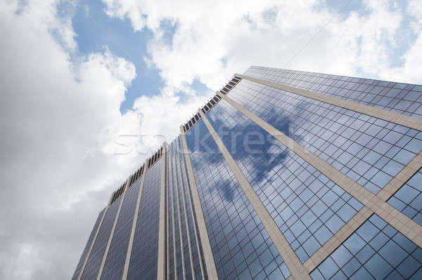 clouds reflected in windows of modern office building Stock photo © artjazz