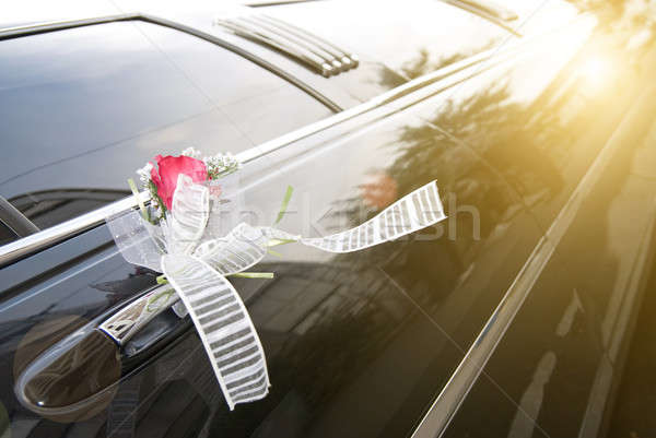 Door of black wedding car with flower and  ribbon Stock photo © artjazz