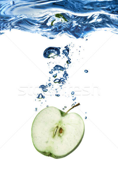 green apple dropped into water with bubbles isolated on white Stock photo © artjazz