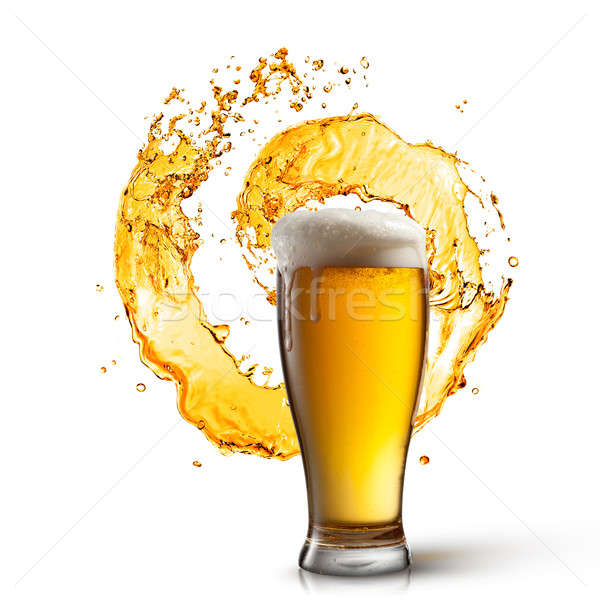 Beer in glass with splash isolated on white Stock photo © artjazz