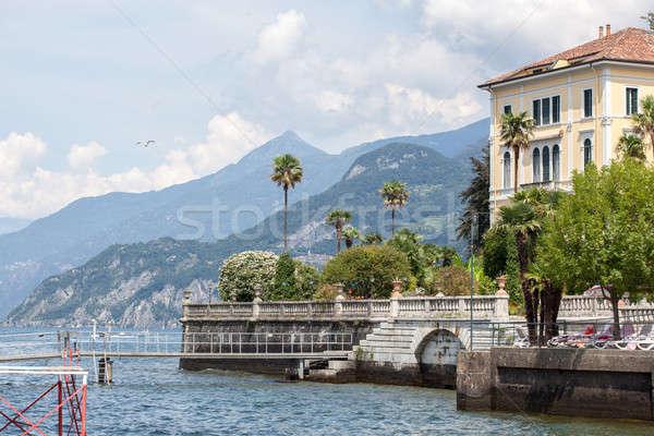 Promenád tó Olaszország égbolt virágok víz Stock fotó © artjazz