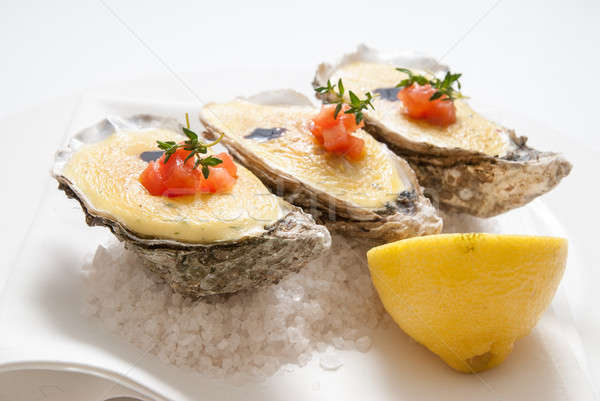 oysters with sauce and lemon on plate Stock photo © artjazz