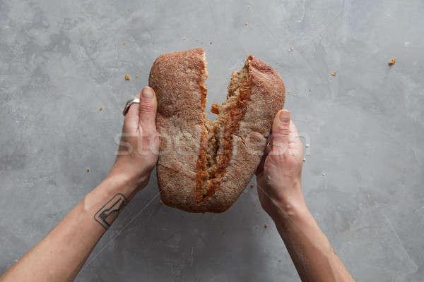 Hand breaks bread Stock photo © artjazz