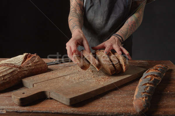 Baker Holds Bran Bread Stock photo © artjazz