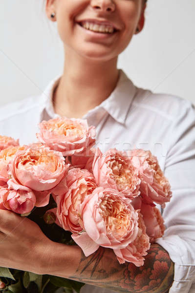 Girl with bouquet of flowers Stock photo © artjazz