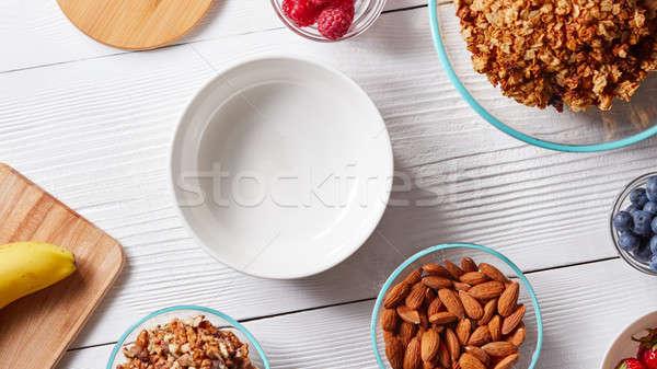 Hozzávalók egészséges reggeli bogyók gabonapehely pelyhek Stock fotó © artjazz