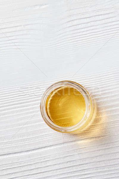 Organik doğal bal cam kavanoz beyaz Stok fotoğraf © artjazz