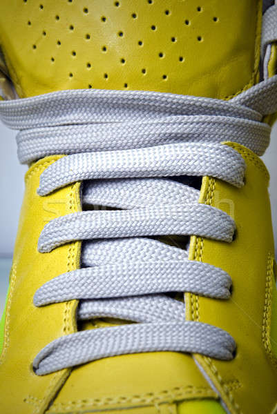 close-up laces on the yellow boots Stock photo © artjazz