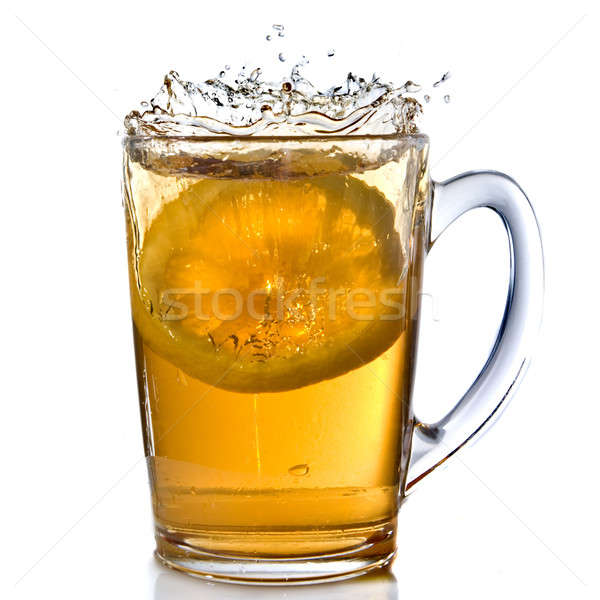 lemon dropped into tea cup with splash isolated on white Stock photo © artjazz