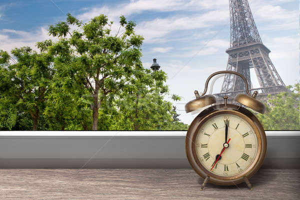View of Paris and Eiffel tower from window with alarm clock Stock photo © artjazz