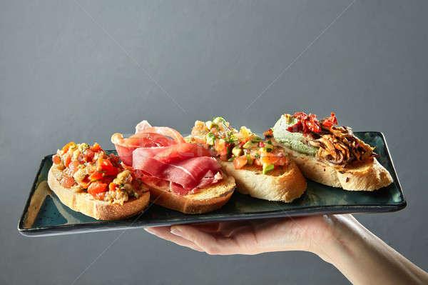 Finom választék olasz bruschetta kerámia tálca Stock fotó © artjazz