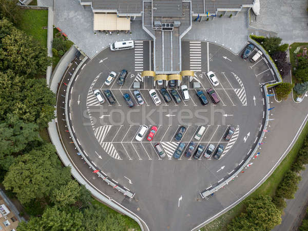 Aerial view from the drone to parking for cars of a round shape with cars on it. Stock photo © artjazz